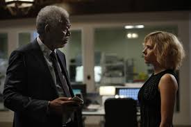 Morgan Freeman as Prof. Norman and Scarlett Johansson as Lucy