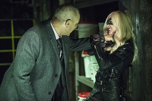 Brick (Vinnie Jones) initiating Laurel (Katie Cassidy) into the world of heroes.